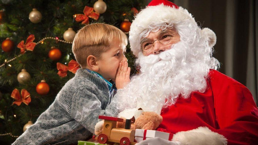 A Boy Whispering To Santa
