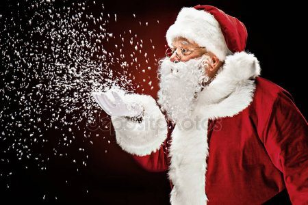 Santa Blowing Snowflakes